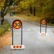 Slow down signs — Stock Photo