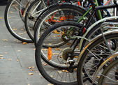 Bicycles parked on street — Stock Photo