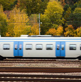 Fast train against Autumn forest — Stock Photo