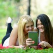 Stock Photo: Friends having fun while surfing on internet outdoors