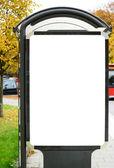 Blank billboard on city bus station — Stock Photo