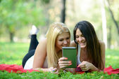 Friends having fun while surfing on internet outdoors — Stock Photo