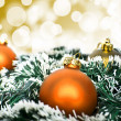 Orange christmas ornament ball against yellow bokeh background — Stockfoto