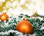 Orange christmas ornament ball against yellow bokeh background — Stock Photo