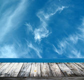 Sea and sky against wooden floor — Stock Photo