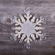 Christmas decorative ornament - Snowflake on wooden background — Stock Photo #35089803