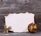 Christmas background with blank vintage paper and golden ornamen — Stock Photo