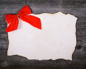 Christmas decoration and vintage paper on wooden background — Stock Photo