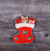 Christmas decorative ornament - Gifts in sock horses on wooden b — Stock Photo
