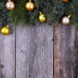 Christmas fir tree with golden decoration on a wooden board — ストック写真