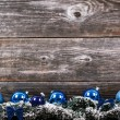 Christmas tree with baubles on wood texture — Stock Photo