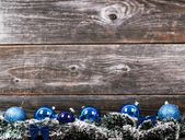 Christmas tree with baubles on wood texture — Stok fotoğraf