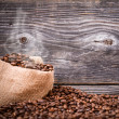 Sack of fresh coffee beans with smoke — Stock Photo