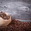 Sack of fresh coffee beans with smoke — Stock Photo #35108929