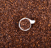 Cup of coffee filled with coffee beans abstract view — Stock Photo