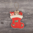 Vintage Christmas decorative ornament - Gifts in sock horses on  — Stock Photo