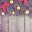 Vintage Christmas fir tree with decoration on a wooden board — Stock Photo