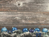 Vintage Christmas tree with baubles on wood texture — Stock Photo
