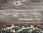 Vintage Christmas tree with golden baubles on wood texture — Stok fotoğraf