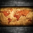 Antique world map in grunge wooden frame — Stock Photo