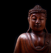 Buddha portrait isolated on black background — 图库照片