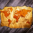 Old world map over wooden background — Stock Photo