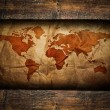 Vintage paper map in old wooden frame — Stock Photo