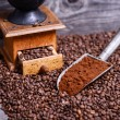 Stock Photo: Antique coffee grinder with grinded coffee in scoop on beans