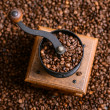 Vintage manual coffee grinder with coffee beans — Stock Photo