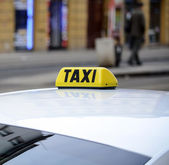 Taxi sign on car — Stock Photo
