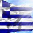 Greece waving flag against blue sky with sunrays — Stock Photo