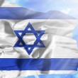 Israel waving flag against blue sky with sunrays — Stock Photo