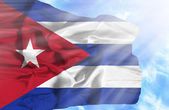 Cuba waving flag against blue sky with sunrays — Stock Photo
