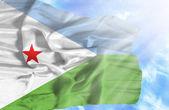 Dijbouti waving flag against blue sky with sunrays — Stock Photo