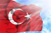 Turkey waving flag against blue sky with sunrays — Stock Photo