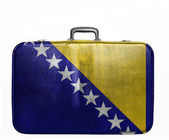 Vintage travel bag with flag of Bosnia and Herzegovina — Stock Photo