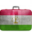 Vintage travel bag with flag of Tajikistan — Stock Photo #39356687