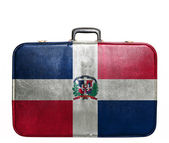 Vintage travel bag with flag of Dominican Republic — Stock Photo