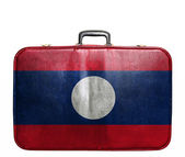 Vintage travel bag with flag of Laos — Stock Photo