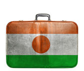 Vintage travel bag with flag of Niger — Stock Photo