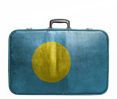 Vintage travel bag with flag of Palau — Stock Photo