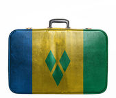 Vintage travel bag with flag of Saint Vincent and Grenadines — ストック写真