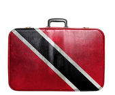 Vintage travel bag with flag of Trinidad and Tobago — Stock Photo