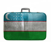 Vintage travel bag with flag of Uzbekistan — Stock Photo