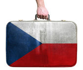 Tourist hand holding vintage leather travel bag with flag of Cze — Stock Photo