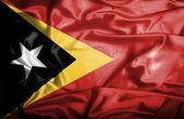 East timor falującej flagi — Zdjęcie stockowe