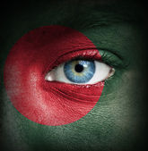 Human face painted with flag of Bangladesh — Stock Photo