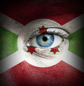 Human face painted with flag of Burundi — Stock Photo