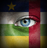 Human face painted with flag of Central African Republic — Stock Photo