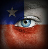 Human face painted with flag of Chile — Stock Photo